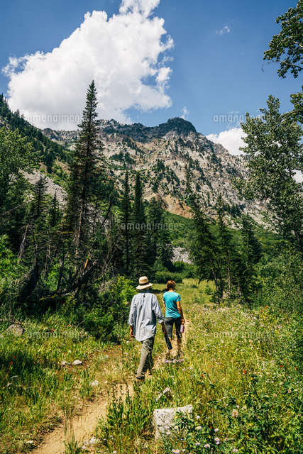 Caucasian couple hiking on path in mountains