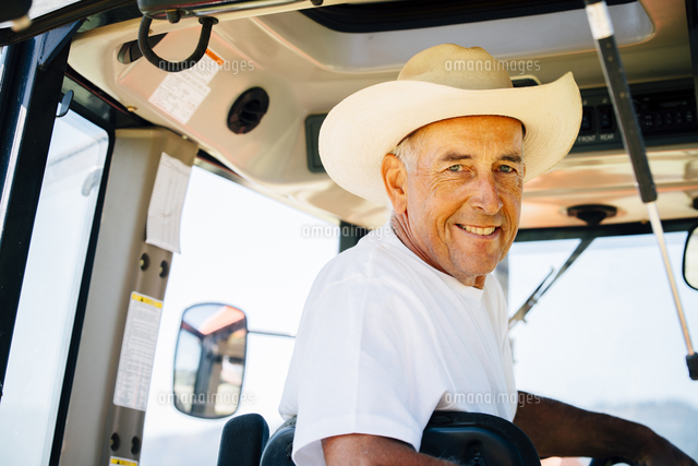 Portrait of smiling Caucasian farmer in tractor