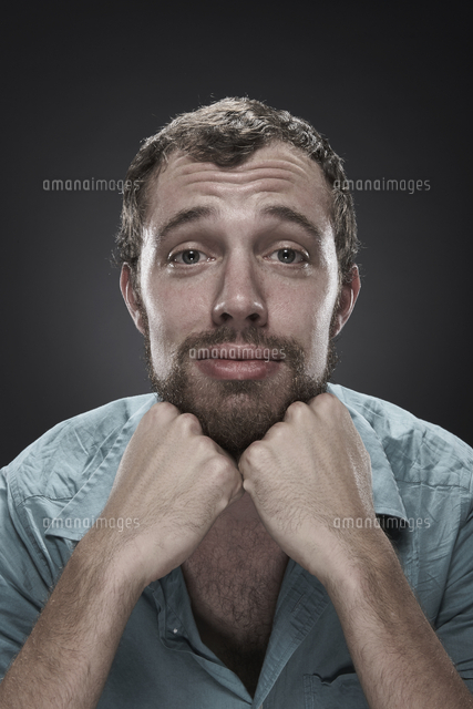 Sad man with hands on chin
