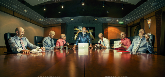 Multiple exposure of Caucasian businessmen in conference room