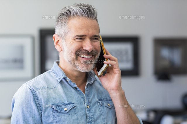 Caucasian man talking on cell phone