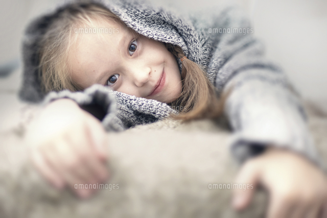 Portrait of smiling Caucasian girl wearing sweater