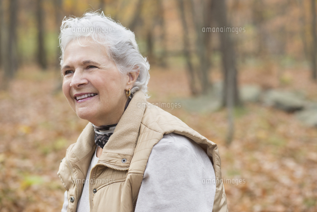 Caucasian woman smiling outdoors in autumn