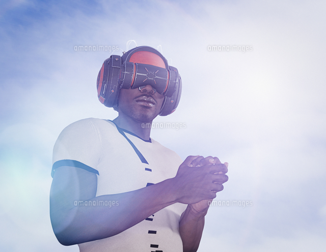Strong man wearing virtual reality helmet
