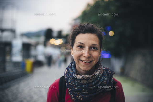 Portrait of smiling Caucasian woman wearing scarf