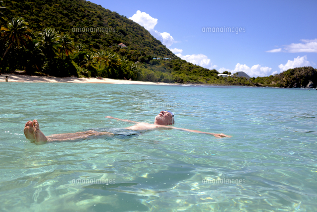 Caucasian man floating in tropical ocean
