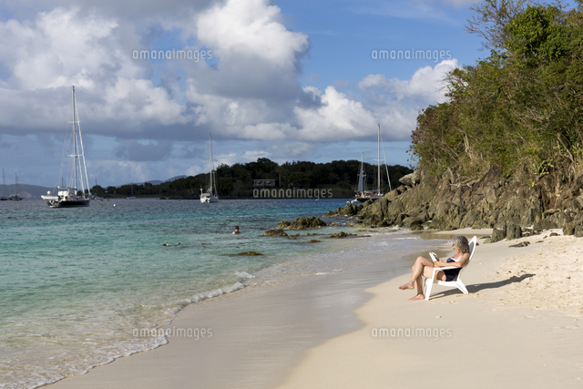 Hispanic woman relaxing on tropical beach