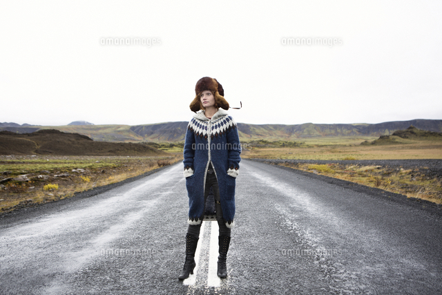 Caucasian woman standing in middle of road
