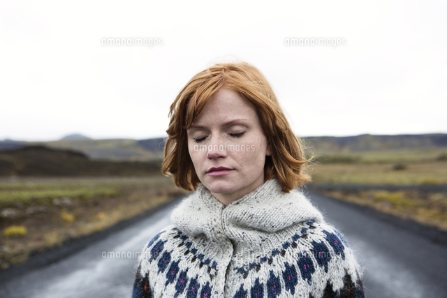 Caucasian woman wearing sweater in road