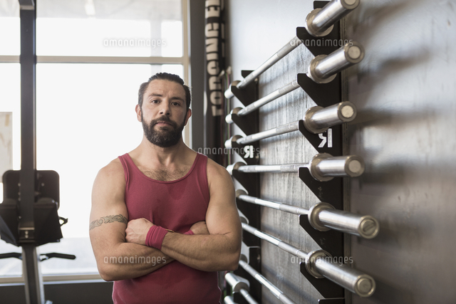 Portrait of serious Mixed Race man posing in gymnasium