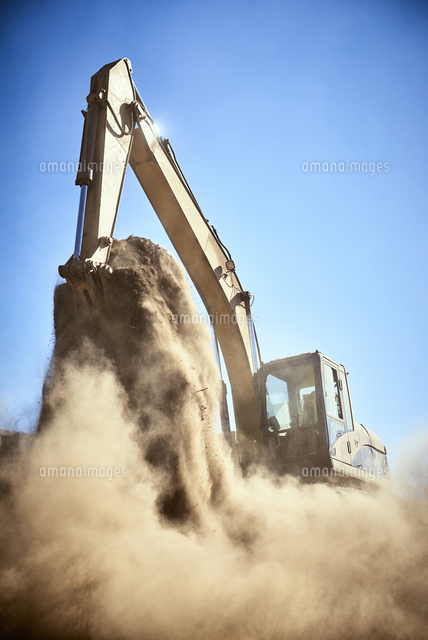 Dust from digger digging dirt