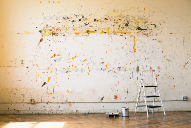 Paint splattered on wall near ladder