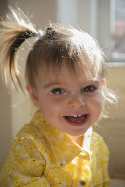 Portrait of smiling Caucasian baby girl