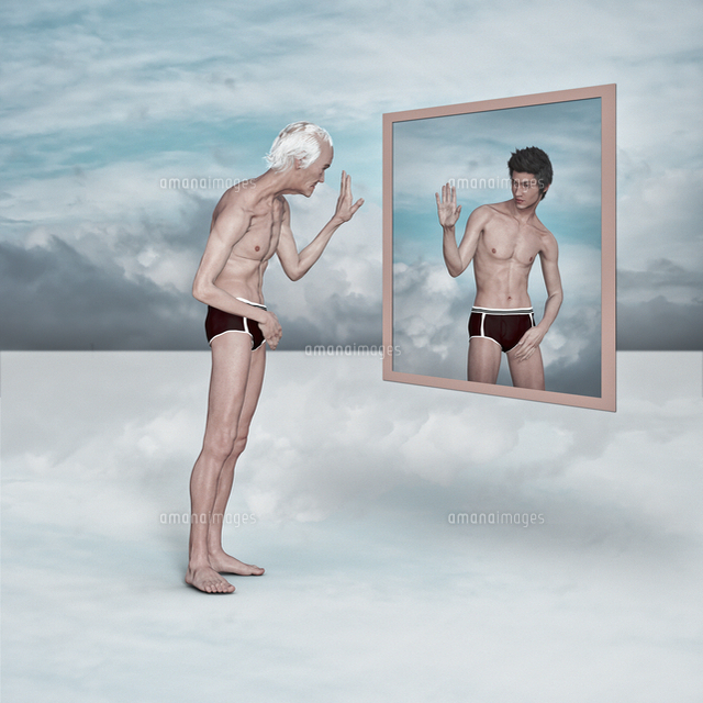 Older man admiring image of younger man in virtual mirror