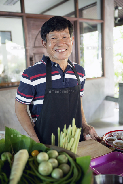 Smiling Thai man preparing food