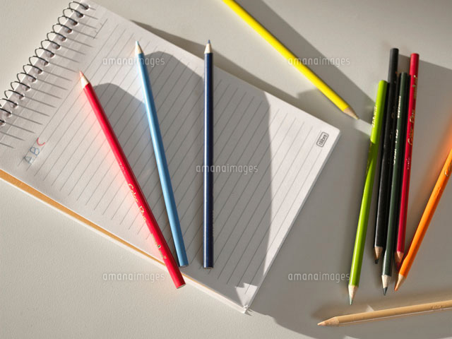 Colored pencils on notepad