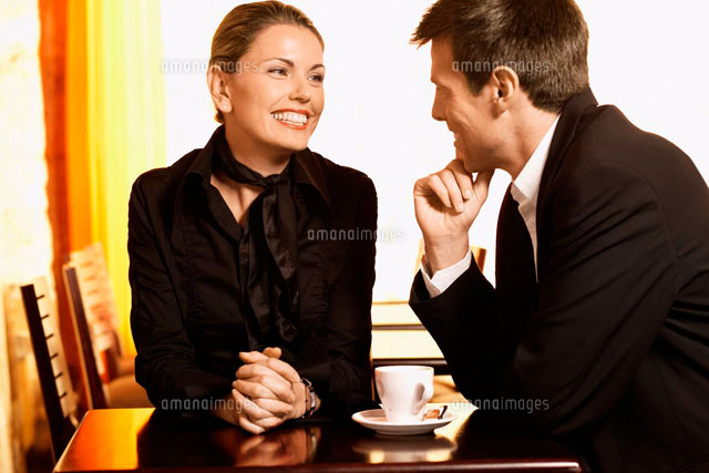 Man and woman talking in cafe