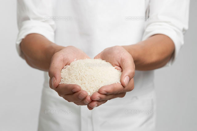 White rice on chefs hands (mid section)