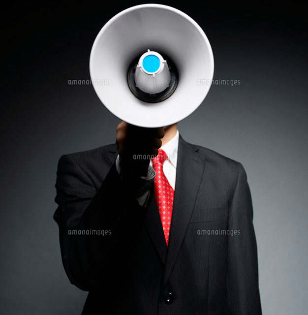 Businessman Holding Bullhorn