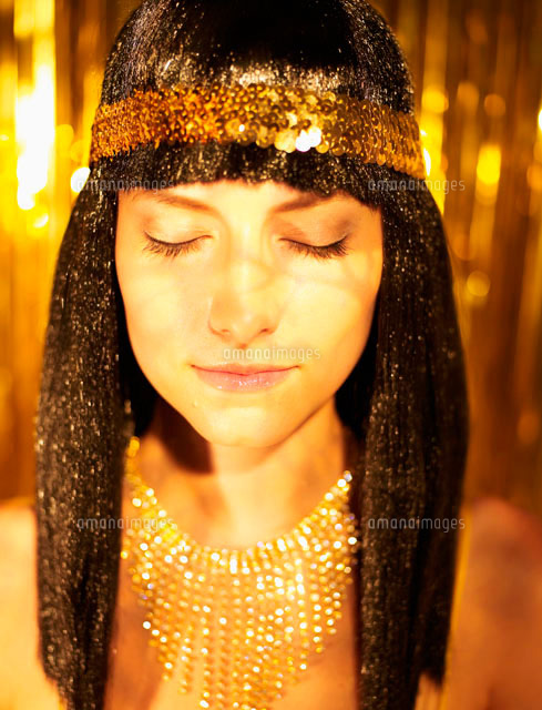 Woman in Wig and Golden Jewelry