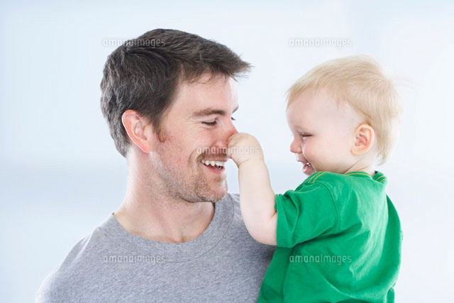Son Pulling Fathers Nose