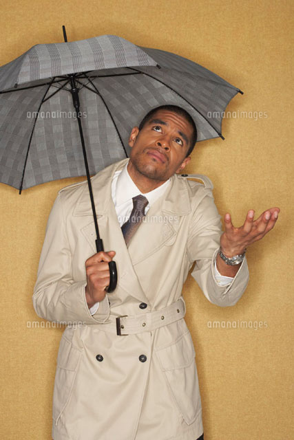 Portrait of Man with Umbrella