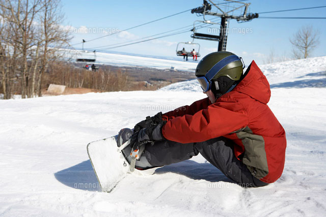 Boy on Ski Hill with Snowboard