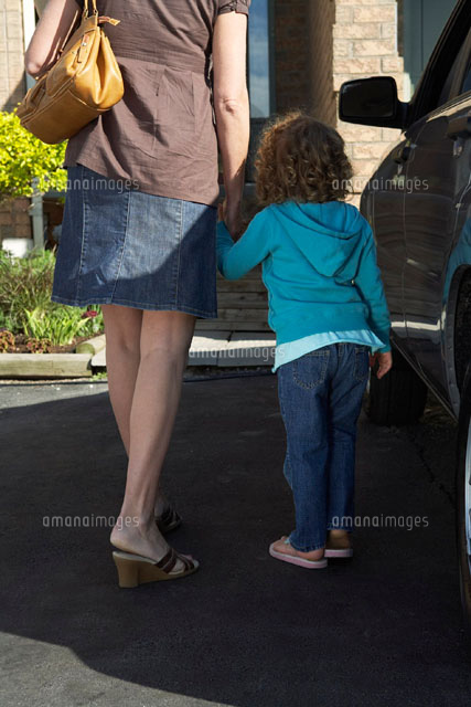 Woman Holding Daughters Hand