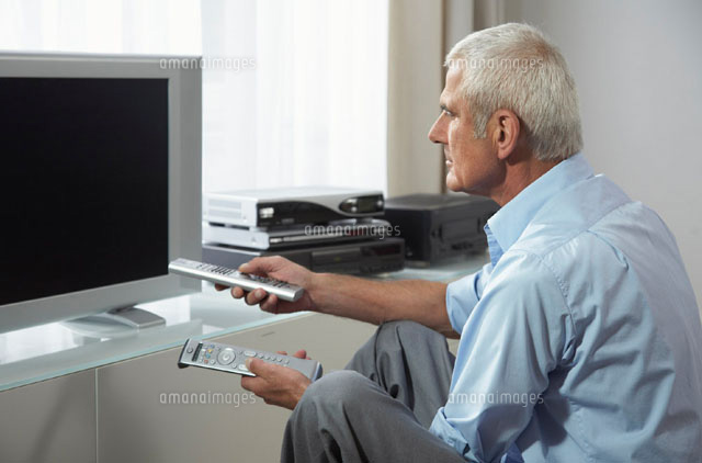 Man Trying to Watch Television