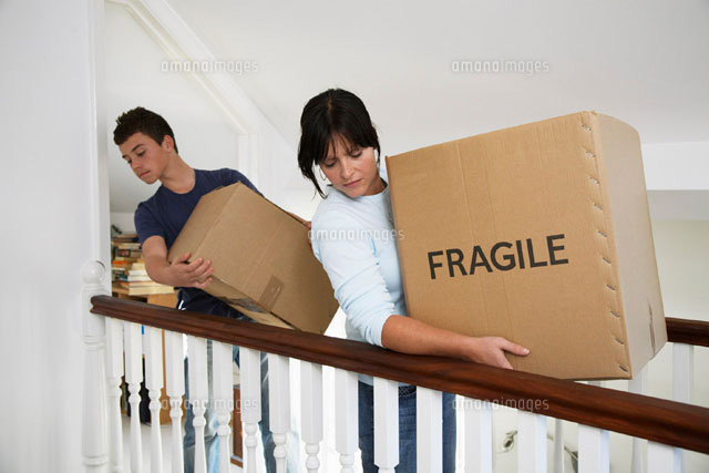 Woman and Boy Moving Boxes