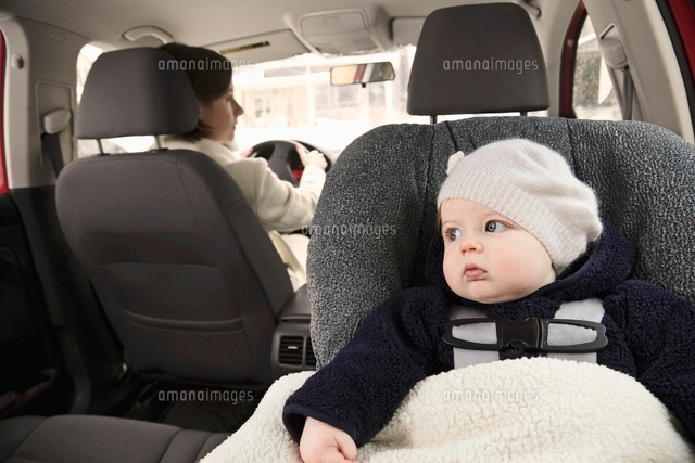Baby in Car Seat with Mother Driving
