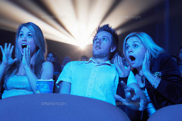 Young People screaming  watching Horror Movie in Theatre
