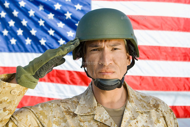 Soldier saluting in front of United States flag  (portrait