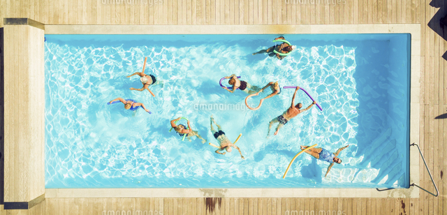 Top view of group of seniors doing water gymnastics in pool