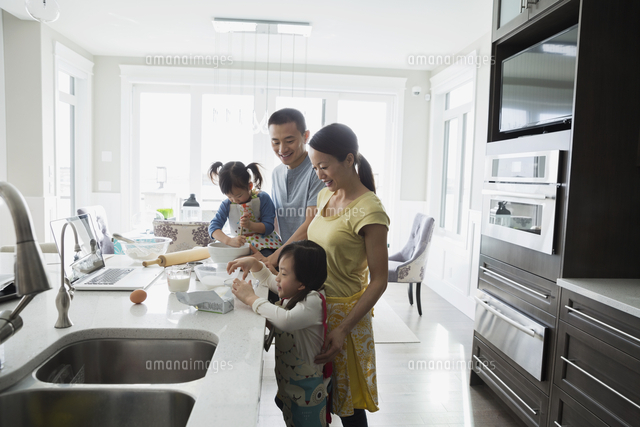 Family baking in kitchen