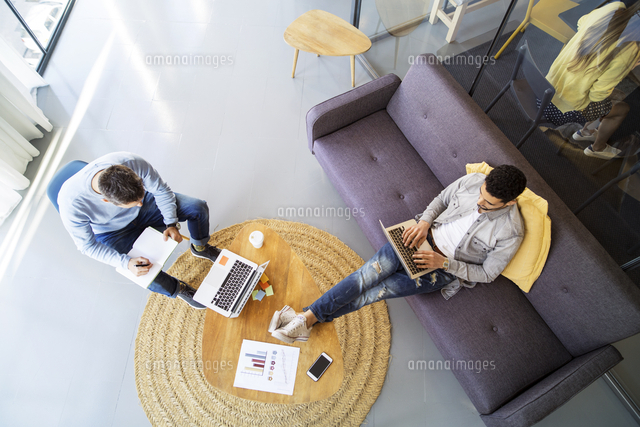 High angle view of male colleagues working in office