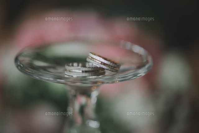 Close-up Of Wedding Rings On Glass
