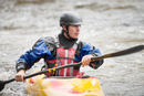 Young male kayaker paddling River Dee rapids