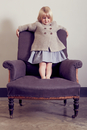 Girl standing on vintage armchair