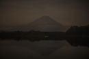 Calm lake against Mt Fuji during sunset, Japan