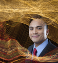 Smiling mixed race businessman surrounded by swirling lines