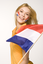 Young woman holding Dutch flag