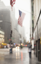 Blurred view of American flags on city street