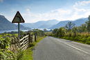 Rural road through scenic Lake District, Ullswater, Cumbria, England
