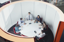 Business people meeting in round open plan conference room