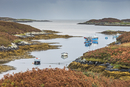View of fishing boats on tranquil lake, Loch Euphoirt, North Uist, Outer Hebrides