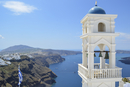 Traditional white bell tower of church on the island of Santorini, Greece.