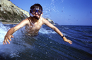 Corfu, Greece, Diving boy at Gardenos Beach