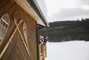 Family on lodge deck over snowy field