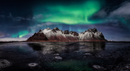 Green aurora borealis over snowcapped mountains by lake at night, Stokksnes, Iceland